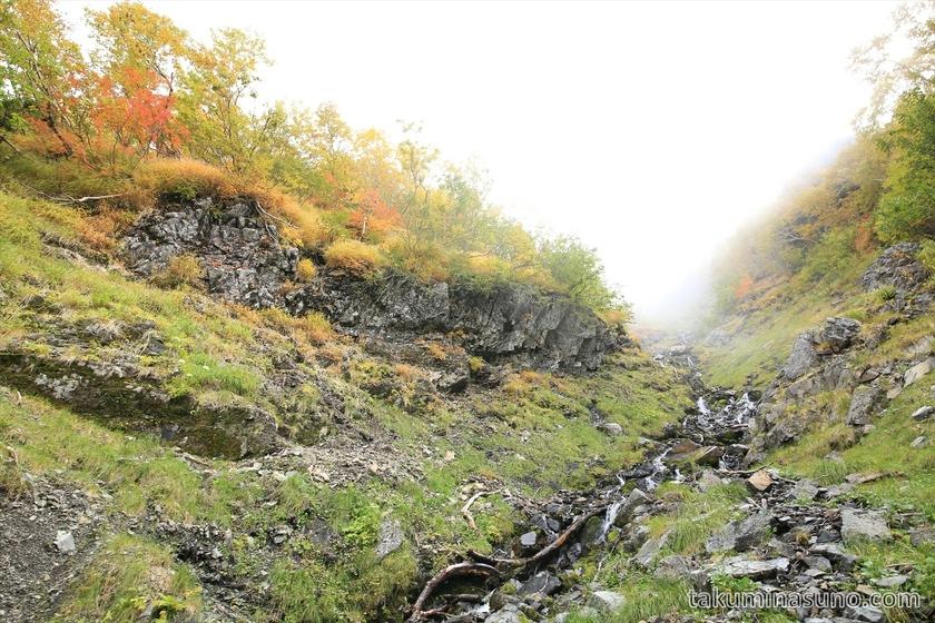 Small waterfall and yellow leaves at Mt Senjougatake