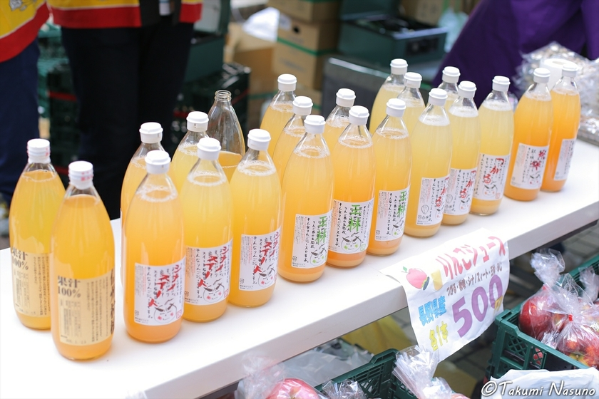 Various Bottles of Apple Juice from Tomi City